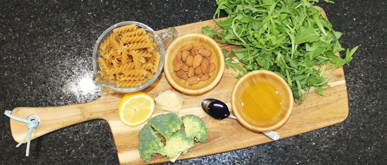 Ingredients for wholewheat pasta with a zingy almond pesto