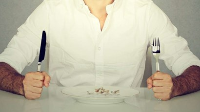 What triggers eating disorders in men?